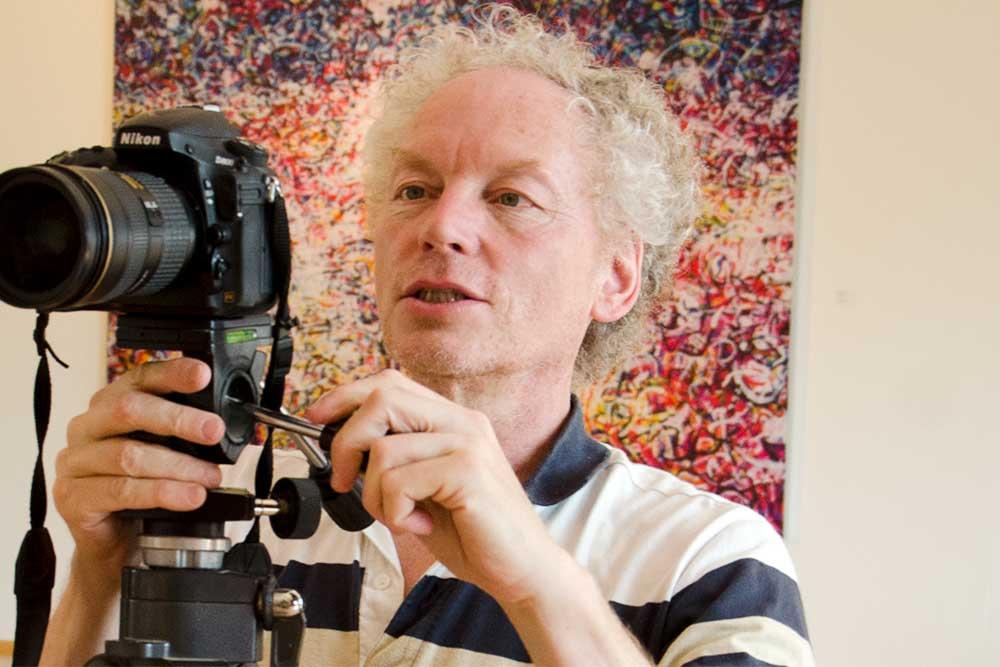 Freifrank Fischer mit Fotokamera – Fotografie von Freifrank